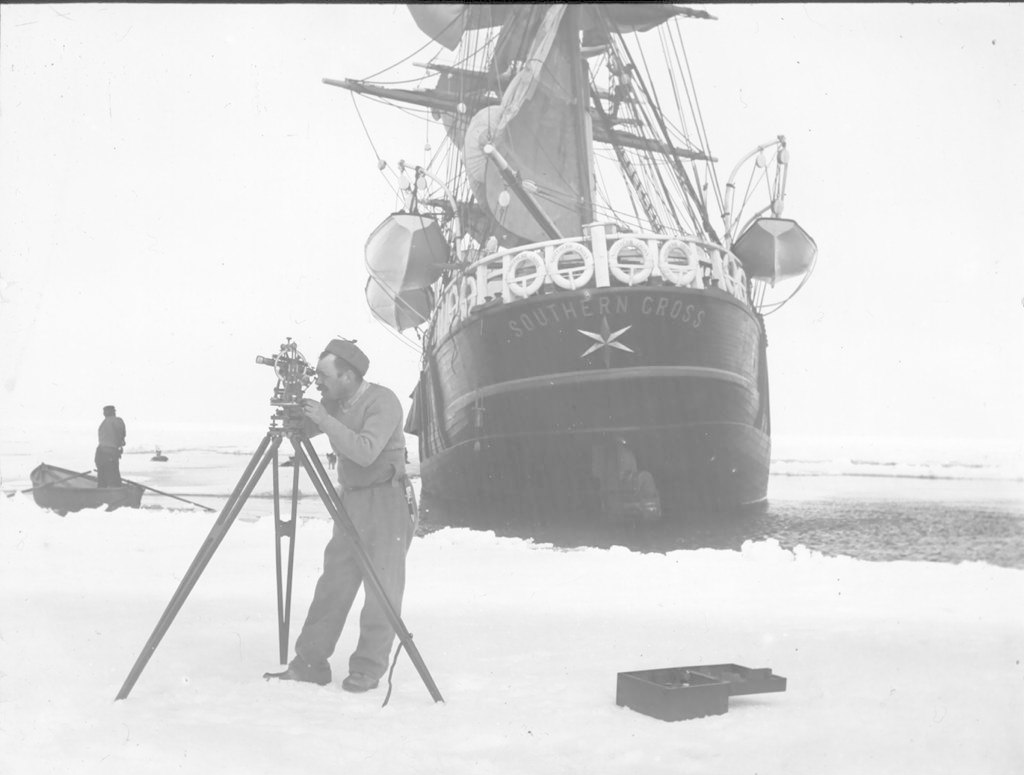 Man doing measurements in front of ship